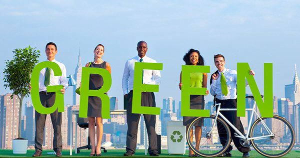 People Holding Letters Spelling GREEN