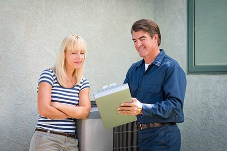 hvac worker consulting with customer