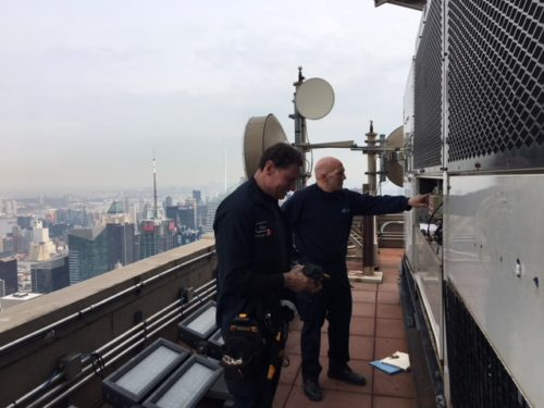 Donnelly's commercial HVAC techs on a NYC rooftop