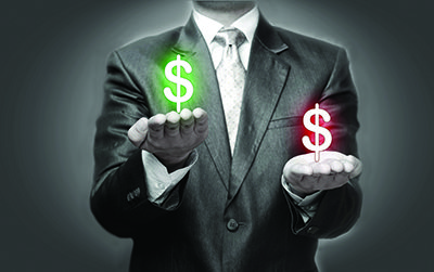 businessman weighing costs in the symbol of dollar signs